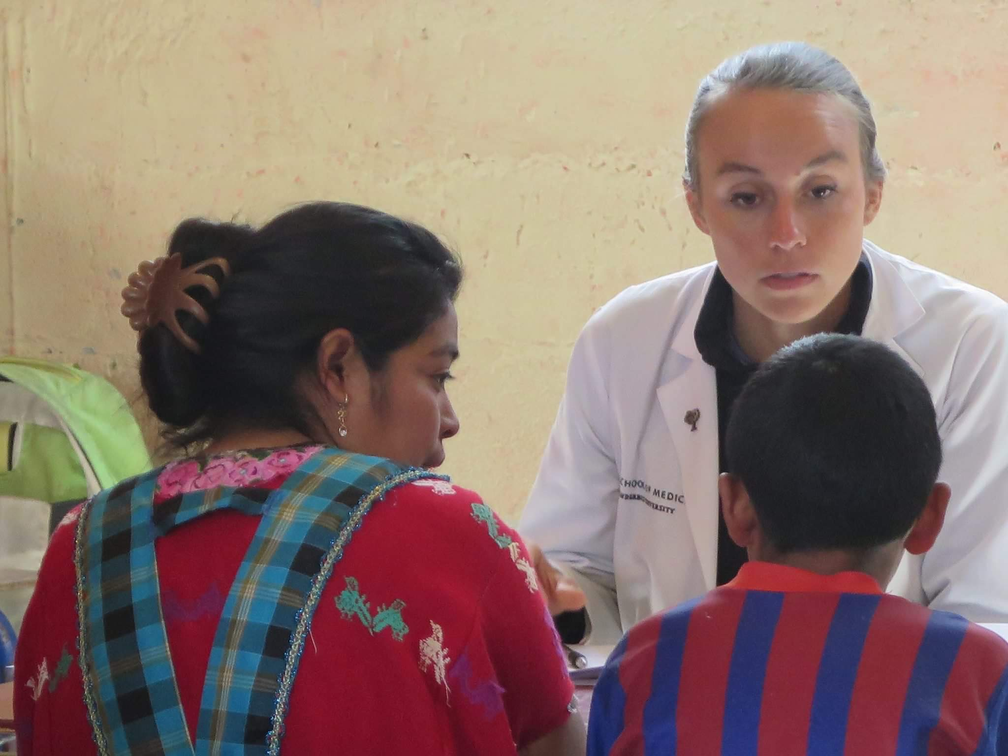 Elizabeth speaking with peds patient in mobile clinic.jpeg