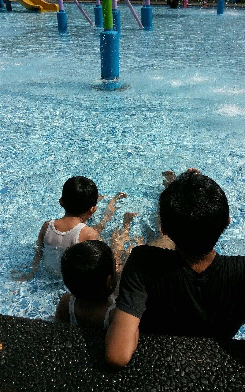 family in splash pad