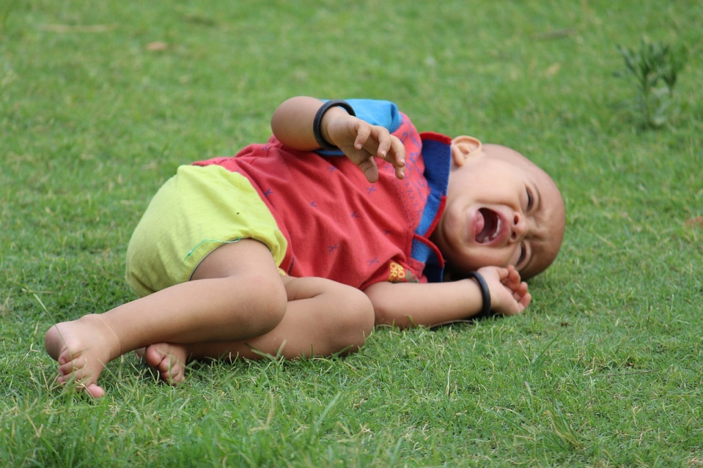 child on ground crying